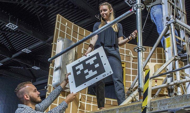 Greta Studier '19 holds 2-dimensional QR Code
