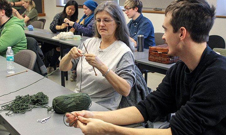 Students learning to knit
