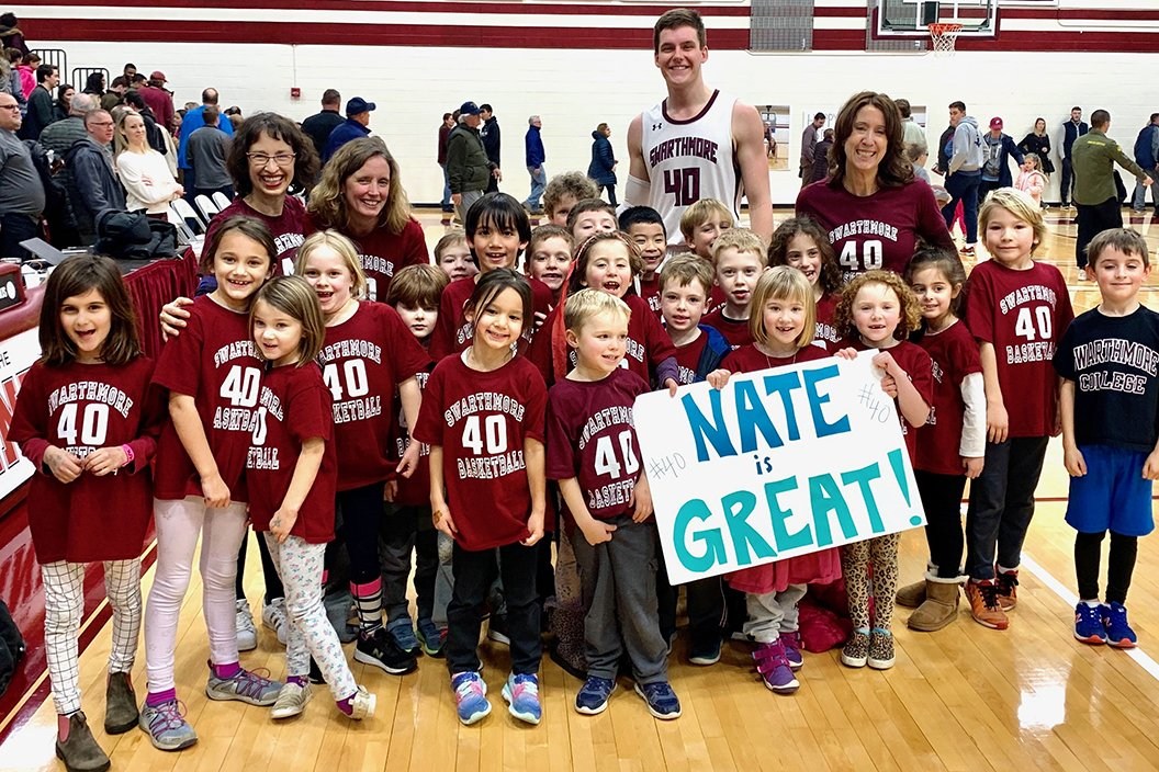 Nate Shafer '20 poses with class of kindergartners