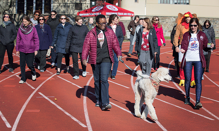 President Valerie Smith leads walkers during the Turkey Trot