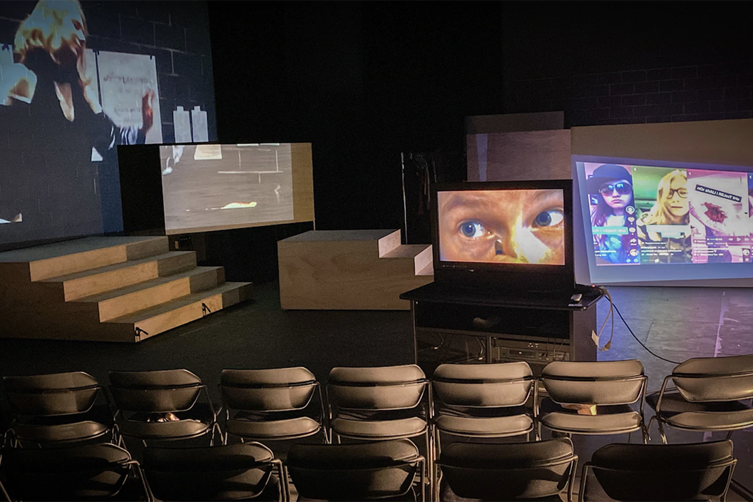 Picture of empty stage in Frear Ensemble Theater with monitors projecting images