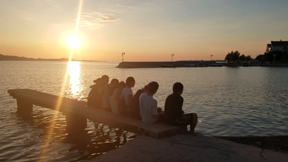 several students at sunset