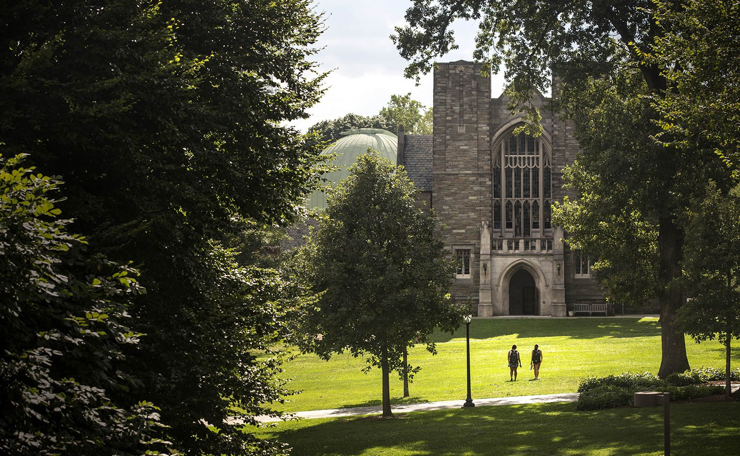 two students walking towards clothier hall