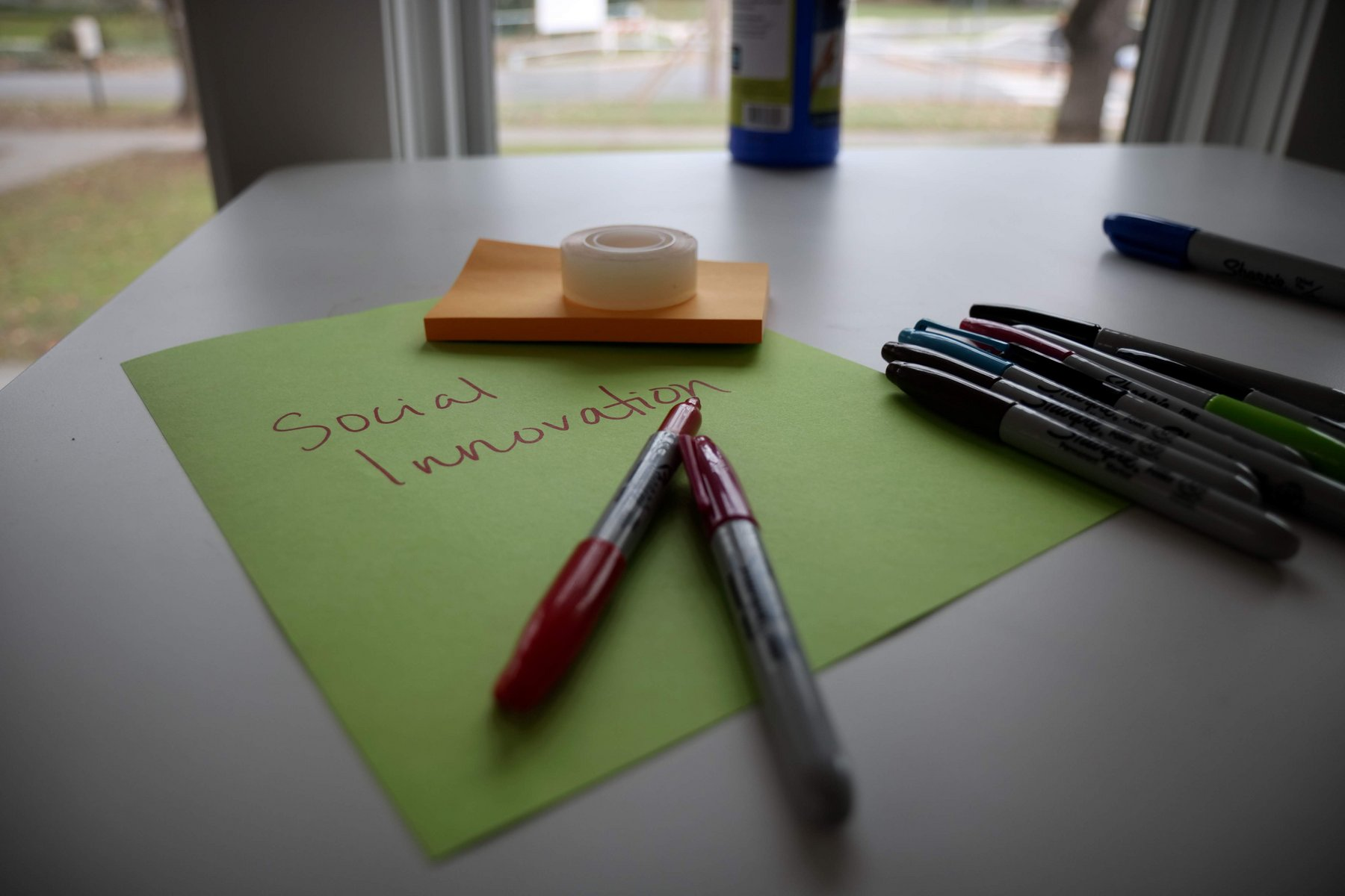 """Markers with a notepad that reads """"Social Innovation"""""""
