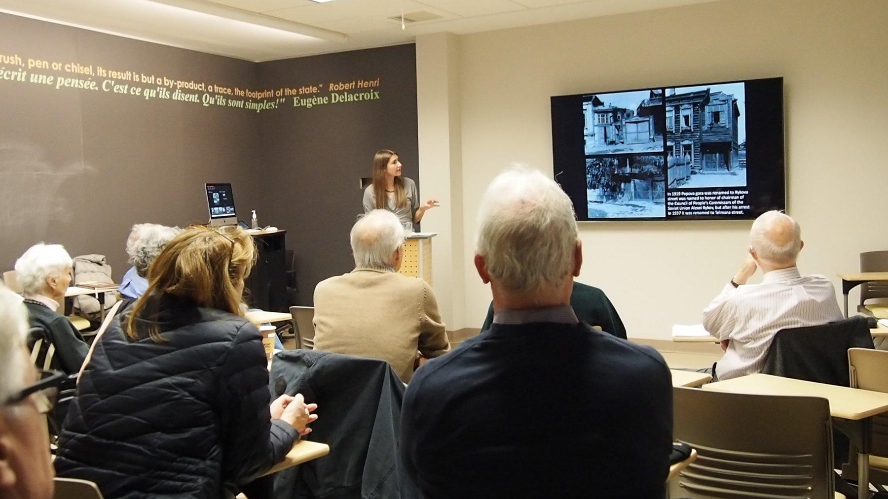 Ramina Abilova giving a presentation in a classroom