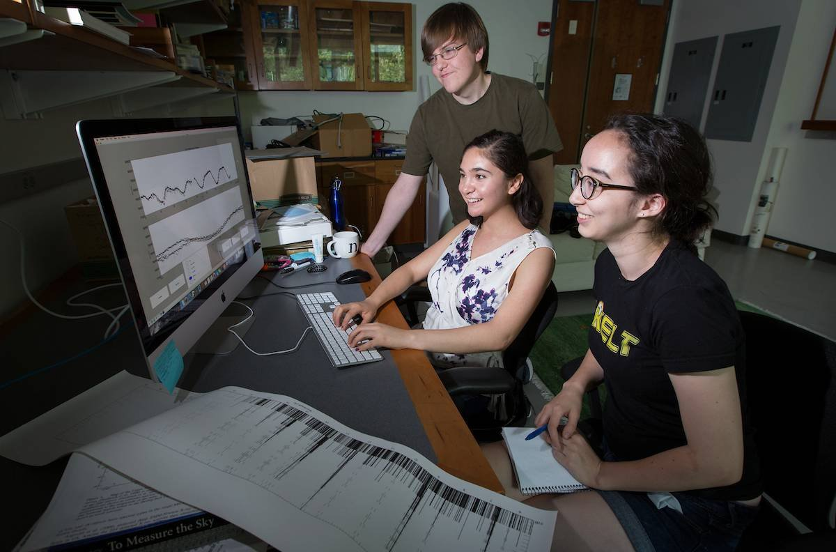 Summer research students Emma Lewis '18, Nicole Banales '18 and Marcus Hughes '18, who is from Williams College, work on astronomy projects on the campus of Swarthmore College on Tuesday, July 28, 2015, in Swarthmore, Pa. (Laurence Kesterson / staff photographer)